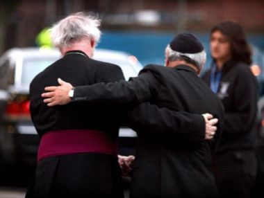The Archbishop of Canterbury, Dr Rowan Williams, embraces Chief Rabbi ...