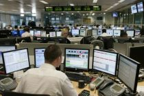 Traders at the London Stock Exchange.  Alpha Chairman Ken Costa said ...