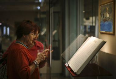 In this file photo, Israeli women observe hand-written verses from ...
