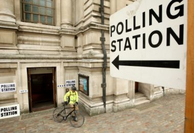 A voter leaves the polling station at the Methodist Central Hall in ...