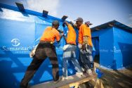Samaritan's Purse employees work in teams to construct thousands of ...