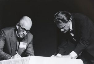 Bishop Jack Dain and Billy Graham sign the Lausanne Covenant at the ...