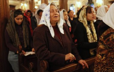 Coptic Christians attend a service at a church in the Rod El Faray ...