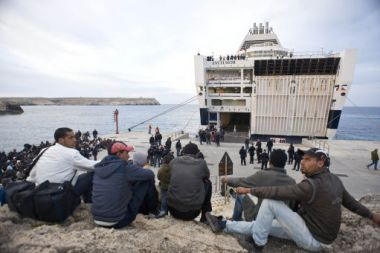 Migrants wait to board a ferry in Lampedusa, Italy, Wednesday, March ...