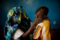 This file photo shows a mass rape victim and her son in the town of ...