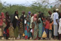 Somali refugees wait to board a bus to another camp, at Ifo, outside ...