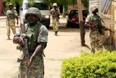 (AP Photo/Jon Gambrell)In this photo dated 6 June 2013, soldiers stand  guard at the offices of the state-run Nigerian Television Authority in  Maiduguri, ...