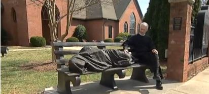 Homeless Jesus Statue Sleeping On A Park Bench In