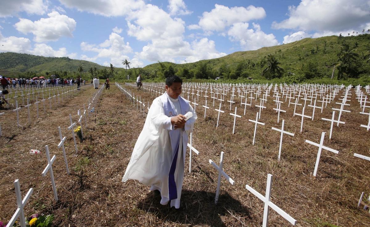 Church bells toll as Philippines remembers thousands killed a year ...