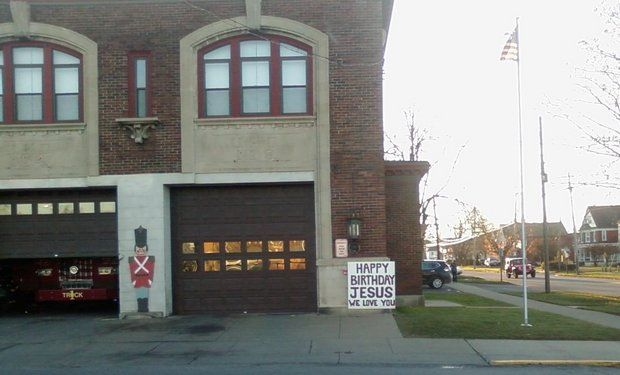 We Love You Jesus sign outside a Utica fire station