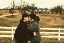 lesbian-couple-kiss-in-front-of-the-duggar-familys-residence