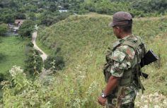 farc-soldier-watches-road