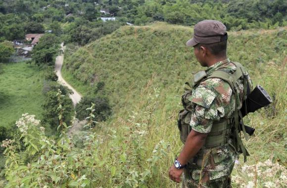 FARC soldier watches road