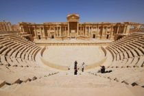 ISIS video shows young militants killing 25 men in Palmyra theatre