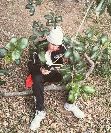 Justin Bieber in the woods