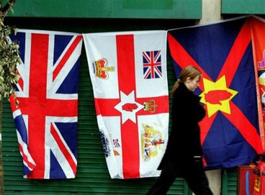 A pedestrian passes flags hung outside a shop selling Loyalist ...