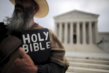 Protester with Bible at US Supreme Court
