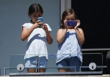 Young girls with cell phones