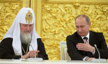 Vladimir Putin with head of Orthodox Church