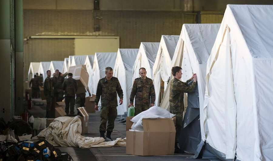 German tents for migrants & Tens of thousands of migrants living in German tents face woes as ...