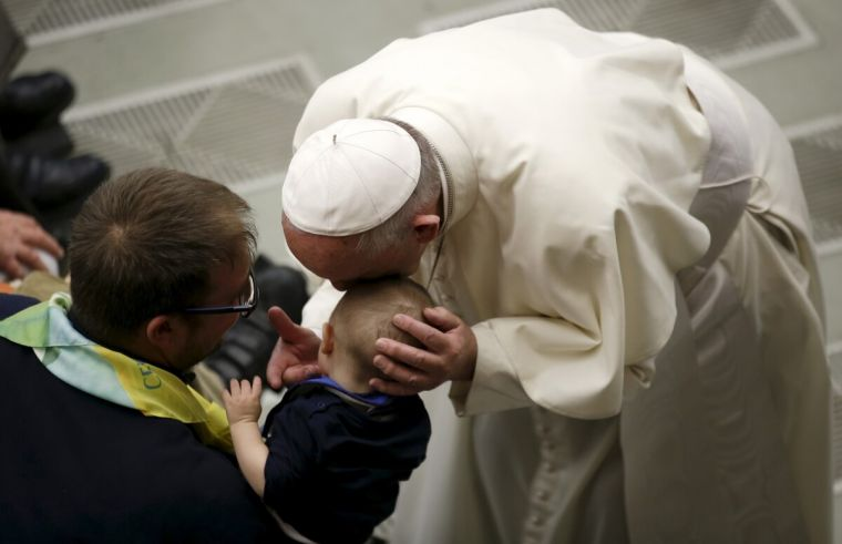 Pope Francis blesses sick boy