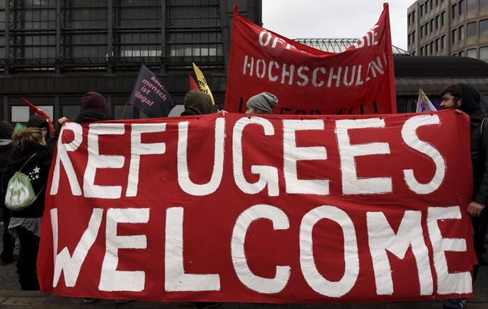 Germans welcome refugees