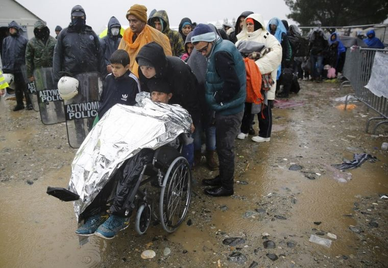 Syrian refugees in the rain