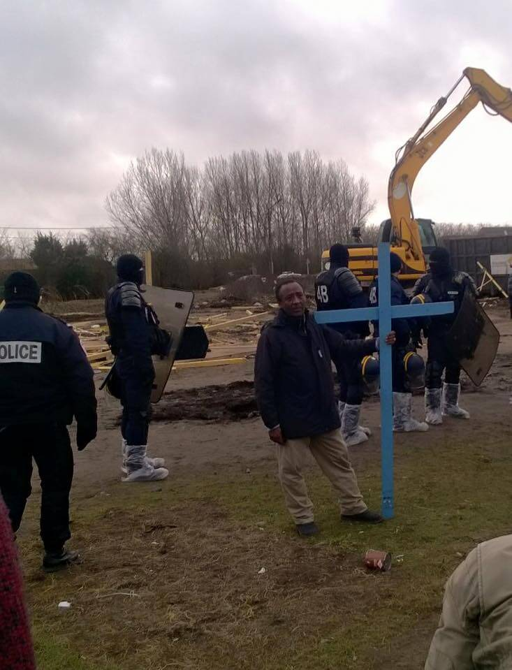 A pastor and cross are all that remain of St Michael's in the Calais jungle
