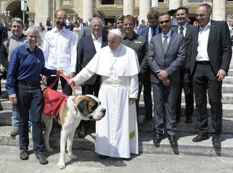 Pope Francis with Magnum St. Bernard dog