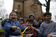 migrant-syrian-kids-in-front-of-german-church