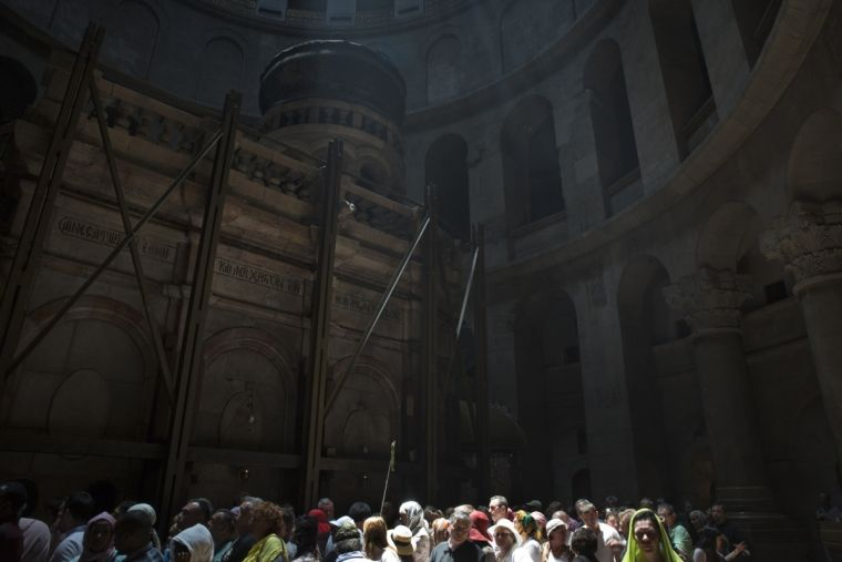 Pilgrims wait in line to enter the Tomb of Jesus inside the rotunda of the Church of the Holy Sepulchre in Jerusalem's Old City