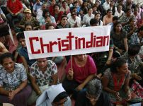 a-protester-holds-a-placard-during-a-rally-in-mumbai-by-hundreds-of-christians-against-attacks-on-churches-nationwide