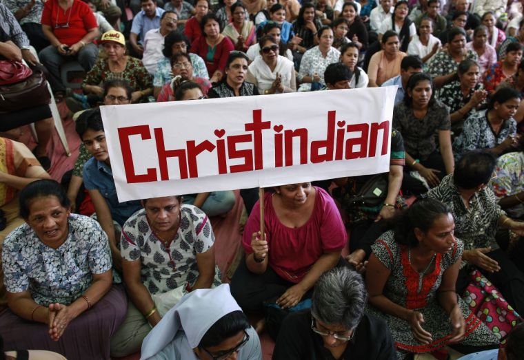 A protester holds a placard during a rally in Mumbai by hundreds of Christians against attacks on churches nationwide.