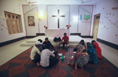 Pakistani Christians sing hymns in Gojra, Punjab in a neighbourhood, known as Christian Colony.