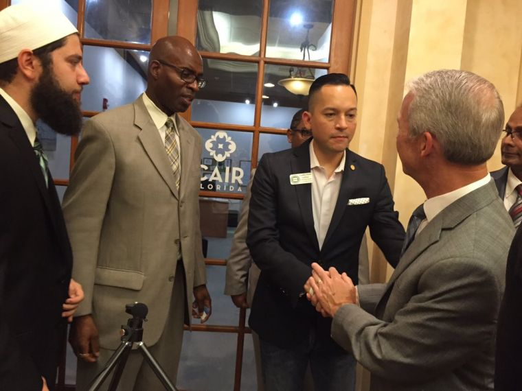 evangelical megachurch pastor Joel Hunter shaking hands with Equality Florida's Carlos Smith.