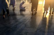 a-man-reads-the-koran-outside-the-al-masjid-al-nabawi-the-mosque-of-the-prophet-after-the-early-morning-prayer-of-al-fajr-in-medina-saudi-arabia