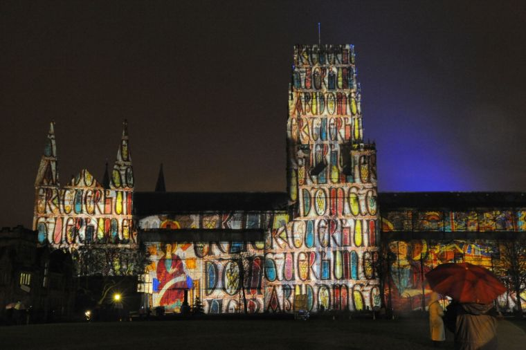 Pages from the Lindisfarne Gospels projected onto Durham Cathederal in Durham.