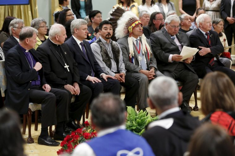 Archbishop Fred Hiltz (L) of the Anglican Church of Canada, along with Catholic Archbishop Gerard Pettipas, Prime Minister Stephen Harper, Inuit National President Terry Audla, Assembly of First Nations National Chief Perry Bellegarde, Justice Murray Sinc