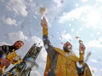 an-orthodox-priest-conducts-a-blessing-in-front-of-the-soyuz-ms-spacecraft