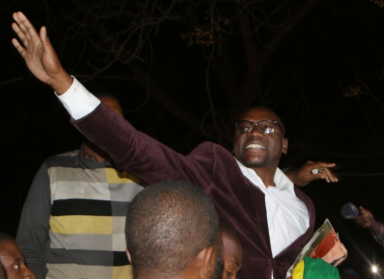 Evan Mawarire is lifted by followers after his release at Harare Magistrates court on July 13.