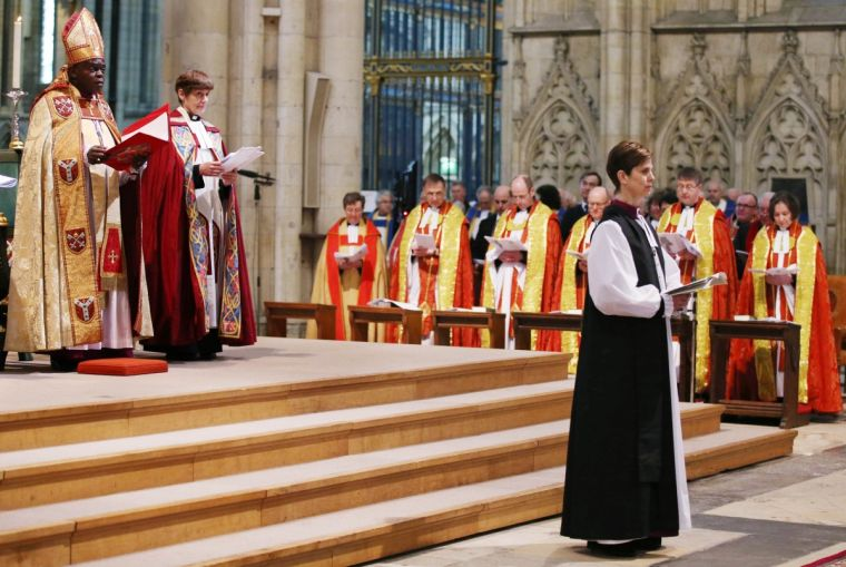 Bishop Libby Lane reads during the service where she was consecrated as the first woman bishop in the Church of England at York Minster