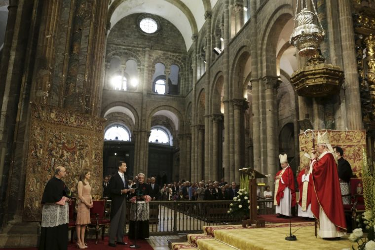 King Felipe of Spain delivers a speech next to Queen Letizia inside the cathedral during celebrations for St James' Day in Santiago de Compostela.