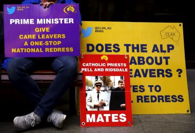 An abuse victim holds a placard outside the venue for Australia's Royal Commission into Institutional Response to Child Sexual Abuse in Sydney, Australia, in a picture taken earlier this year.