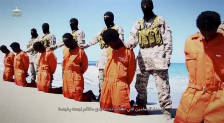 Islamic State militants stand behind Ethiopian Christians along a beach in Wilayat Barqa in a still from a video last year that showed the shooting and beheading of about 30 Ethiopian Christians in Libya.