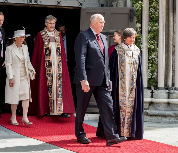 Bishop Helga Haugland Byfuglien with Norway's Queen Sonja and King Harald, and Bishop Tor Singsaas, leaving a service in the Nidaros Cathedral in Trondheim earlier this year