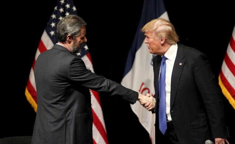 Republican presidential candidate Donald Trump shakes hands with Jerry Falwell Jr, president of Liberty University at a campaign town hall in Davenport, Iowa earlier this year.