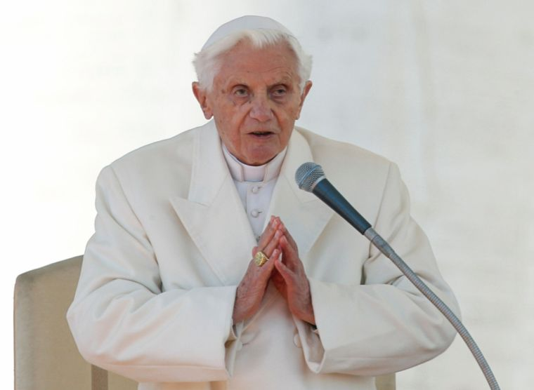 Pope Benedict XVI finishes his last general audience in St Peter's Square at the Vatican on February 27, 2013.