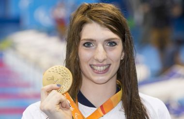 Bethany Firth prays thanks for her Paralympic gold medal