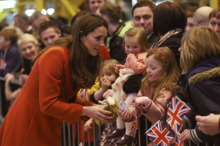 Catherine, Duchess of Cambridge speaks with well-wishers during a visit to Barrow-in-Furness, northern England in 2013.