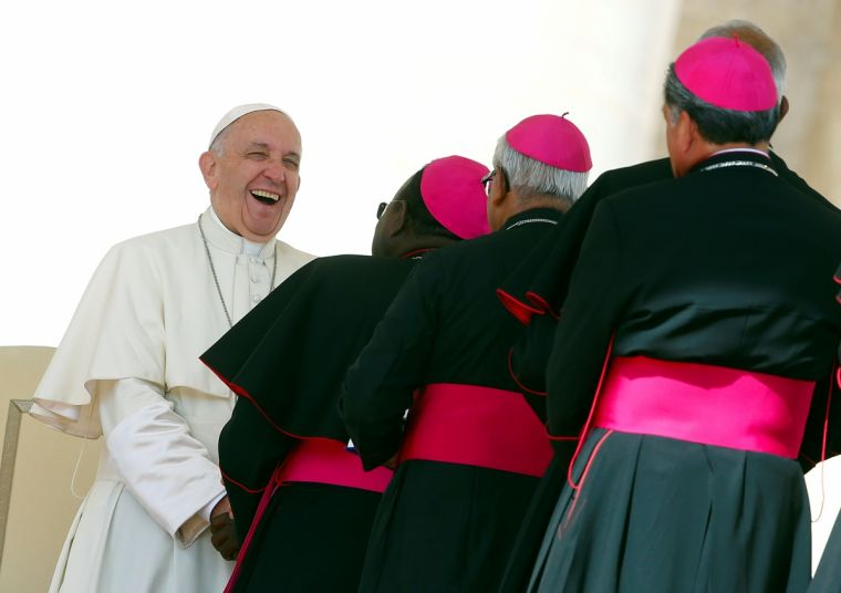 Pope Francis smiles as he greets bishops at the end of his Wednesday general audience in Saint Peter's square at the Vatican last week.